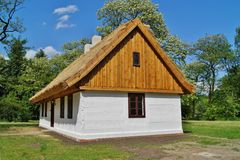 Old wooden house with straw roof Stock Photo