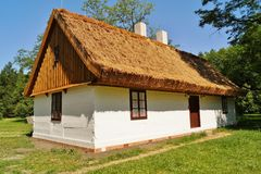 Old wooden house with straw roof Stock Image