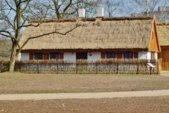 Old wooden house with straw roof Royalty Free Stock Photo