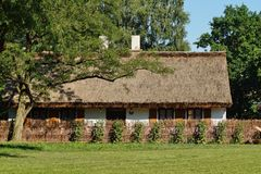 Old wooden house with straw roof Royalty Free Stock Photos