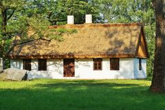 Old wooden house with straw roof Stock Photography