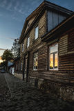 Old wooden house at sunset. Reflecting in the windows. Taken in Kuldinga, Latvia Stock Photography