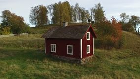Old wooden house in Sweden. At dusk stock video footage