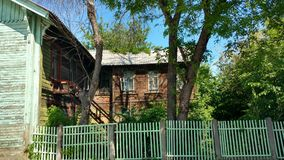 Old wooden house in Syzran. Old house among the trees in the city of Syzran Stock Images