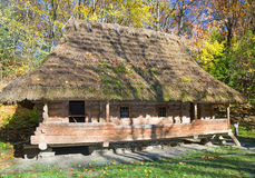 Old wooden house with thatched roof Stock Photo