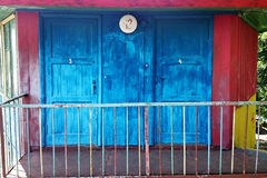 Old wooden house with two blue doors Stock Photography