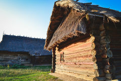 Old wooden house in the Ukrainian village. The traditional housing for the residents of the Ukrainian village. The roof is made of straw royalty free stock photos
