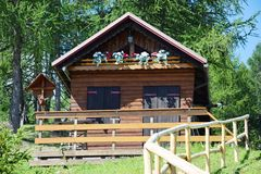 Old wooden house in Cadore, Dolomity mountains, Italy Stock Photo