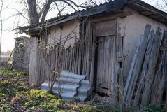 Old wooden house in village. Broken home stock images