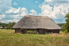 Old wooden house in village. Old wooden house in village stands in a field Stock Images
