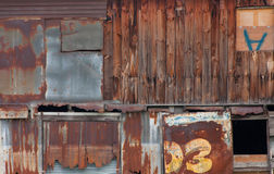 Old wooden house wall and decay zinc window Stock Images