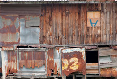 Old wooden house wall and decay zinc window Stock Photo