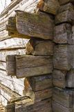 Old wooden house wall of logs for background, wallpaper. Screen saver royalty free stock photo