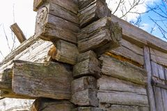 Old wooden house wall of logs for background, wallpaper. Screen saver royalty free stock image
