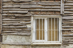 Old wooden house wall paneling and window Stock Image