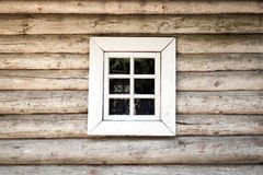 Old wooden house wall with window, background texture Stock Images