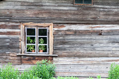 Old wooden house with window Stock Photos