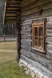 Old Wooden House With Window. Agricultural buildings of wood and stone with thatched roof Royalty Free Stock Photo