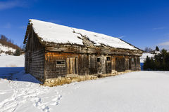 Old wooden house in winter landscape Royalty Free Stock Photos