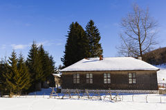 Old wooden house in winter landscape Royalty Free Stock Photography