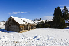 Old wooden house in winter landscape Stock Images