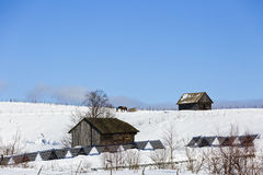 Old wooden house in winter landscape Stock Photography