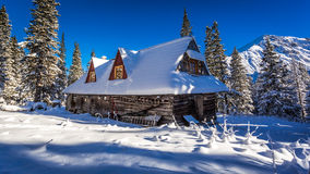 Old wooden house in winter mountains Royalty Free Stock Image