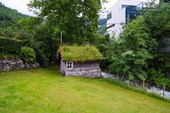 Free Old Wooden House With Grass Roof In Geiranger, Norway. Traditional Norwegian Village House On Summer Landscape. Architecture, Trad Royalty Free Stock Image - 112588666