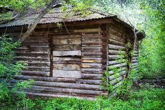 Old wooden house in the wood Royalty Free Stock Image
