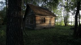 Old wooden house in the woods near the lake Svir at sunrise stock video footage