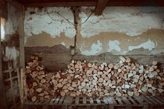 Firewood and old house indoor in Serbia, Subotica stock photography