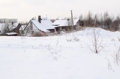Old wooden houses with abundant snowy rooftops Royalty Free Stock Photos