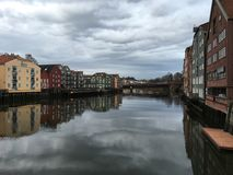 Old wooden houses with Nidelva river, Trondheim, Norway. royalty free stock photography