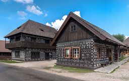 Old wooden houses with a painted traditional pattern. stock photo