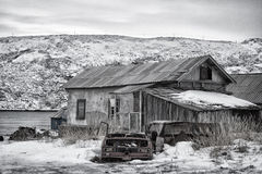 Old wooden houses and the remains of rusty cars Royalty Free Stock Images