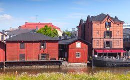 Old wooden houses on the river coast, Porvoo. Porvoo, Finland - June 12, 2015: Old red wooden houses on the river coast in historical Finnish town Royalty Free Stock Photos