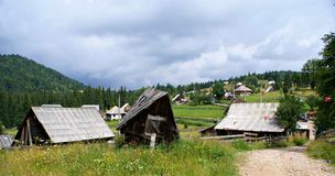 Old wooden houses in a  romanian  mountain village Stock Photo
