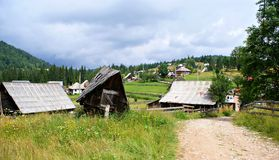 Old wooden houses in a  romanian  mountain village Stock Photos