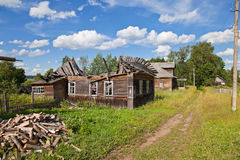 Old wooden houses in russian village Stock Photography