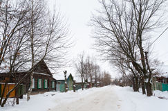Old wooden houses and trees. Rostov Veliky, Russia. Wintertime. Stock Photos