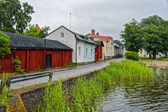 Old wooden houses on waterfront. Old wooden houses on the coast of the Baltic sea at rainy day. Tammisaari, Finland royalty free stock image