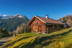 Old wooden hut cabin in mountain alps Stock Photos