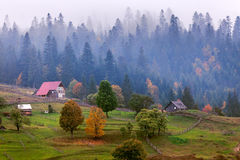 Old wooden hut cabin in mountain at rural fall landscape Stock Image