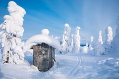 Free Old Wooden Hut In Winter Snowy Forest In Finland, Lapland. Stock Photos - 128596493