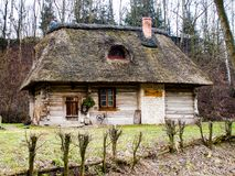 Old wooden hut from XVII century. Old wooden hut located in Lubelskie region in Poland with thatched roof Stock Image
