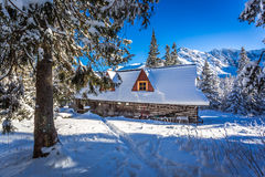Old wooden hut in winter mountains Royalty Free Stock Photos