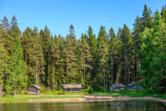 Old wooden huts in forest Royalty Free Stock Photos