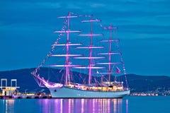 Old wooden illuminated sailboat night view. In Zadar, Dalmatia, Croatia royalty free stock photography
