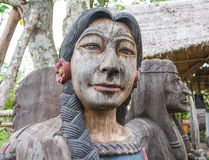 Old wooden indian lady. In the garden Stock Photo