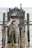 Old Wooden Jetty. An old wooden jetty going out to the ocean Stock Photography